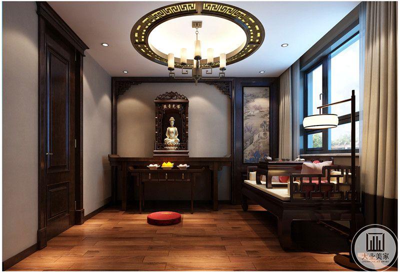 书房装修效果图:地板使用木地板,业主信佛所以特意制作佛龛,右侧是中式风景画。