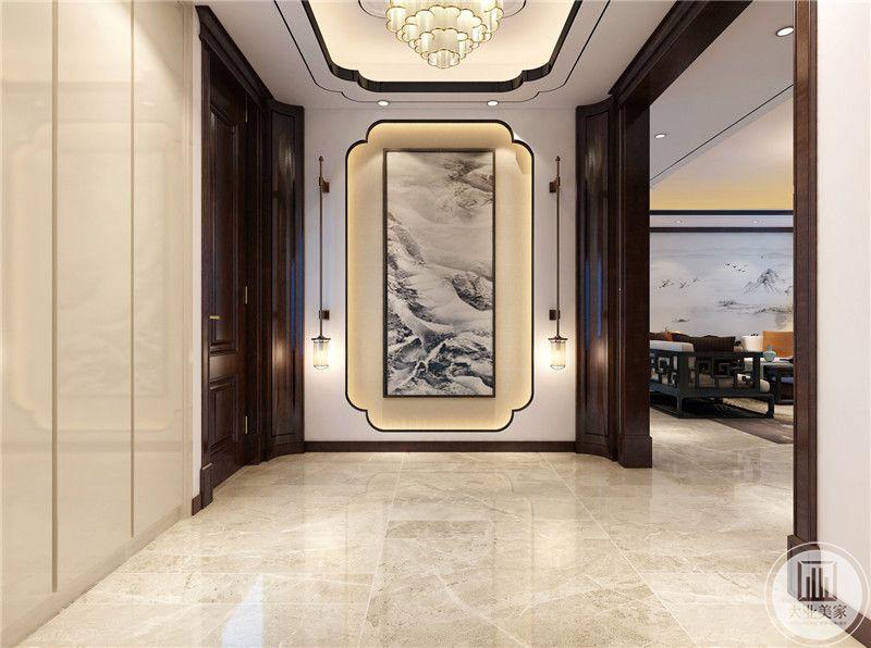 玄关装修效果图:玄关直接使用中式山水画,两侧采用中式壁灯。