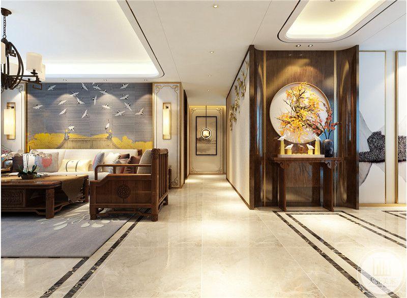 玄关背景墙面采用红木材料,搭配圆形中式装饰画。