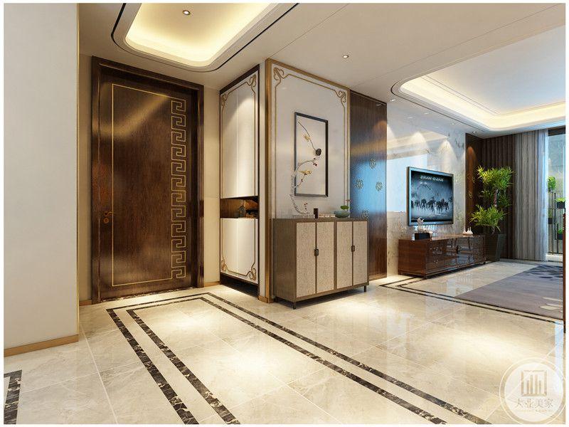 入户空间的一侧采用白色中式装饰画,搭配白色橱柜。