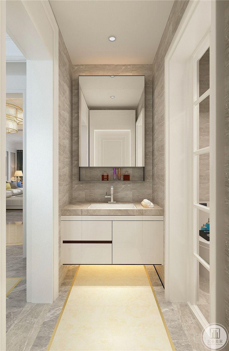 卫生间墙面主要以浅棕色大理石为主,橱柜以白色为主。