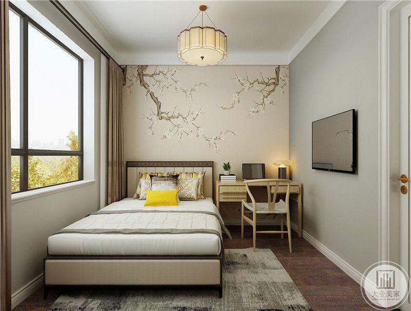 次卧室床头背景墙采用浅黄色景物壁纸,一侧放置实木书桌。